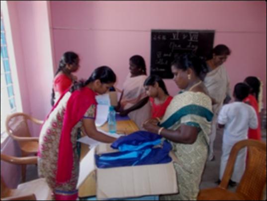 Handing the school uniform to a parent