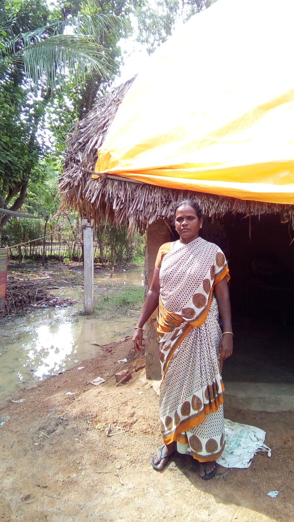 A tarpauline sheet covers flood affected house