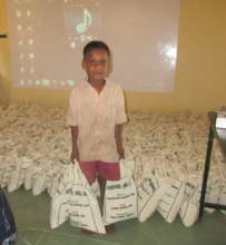 Orphan boy gives helping hand to transport relief