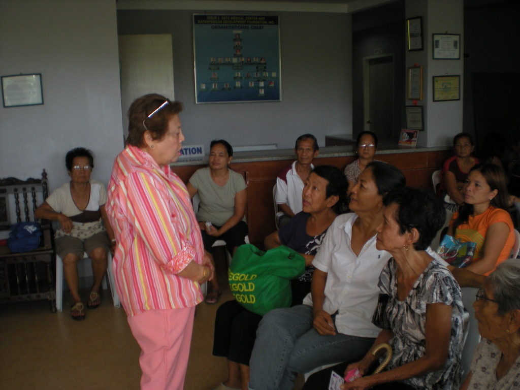 Mrs. Joan A. Datu with patients