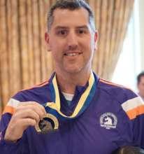 Matt proudly displaying his Boston Marathon medal!