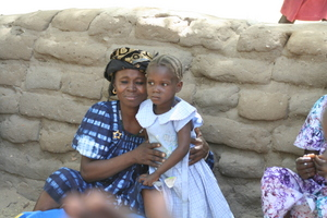 A mother embraces her daughter in Mali