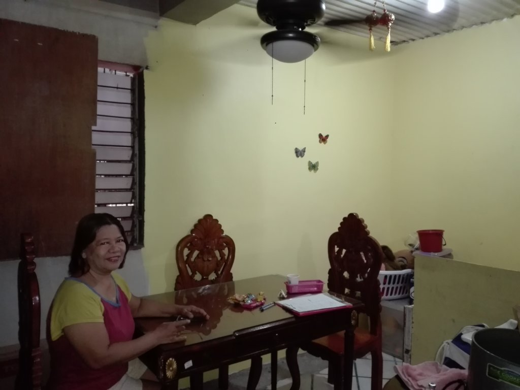 A homeowner in her newly-retrofitted dining room
