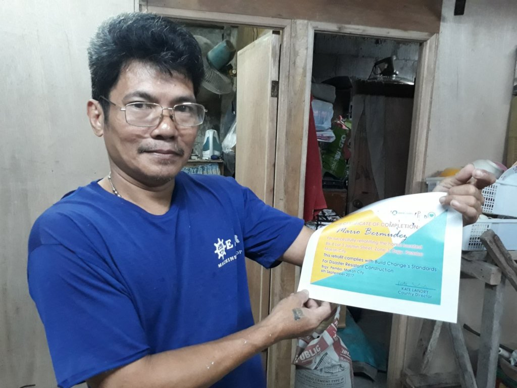 A homeowner shows his certificate of retrofit