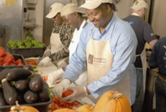 Volunteers prep local produce for meals.