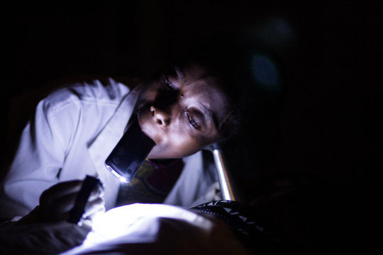 Midwife checking fetal heartbeat using phone light