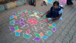 Colorful rangolis were made by children and women