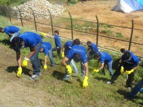Volunteers undertake de-weeding around lake