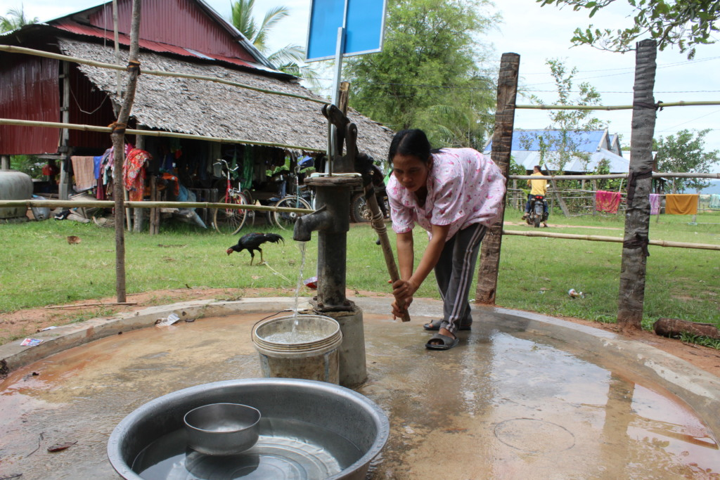 Thong pumps water from the new well