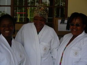 Volunteers receive towelling robes as gifts