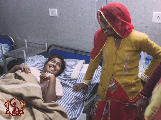 A smiling Pooja and her mother after the operation
