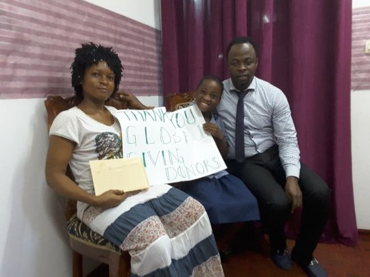 Mbong and her mother receiving funds