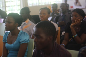 Trainees listen attentively during conference