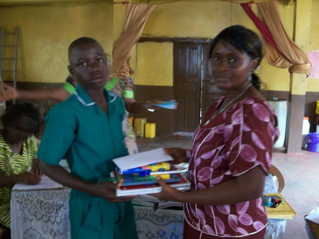 Ishmael receives scholarship funds and supplies