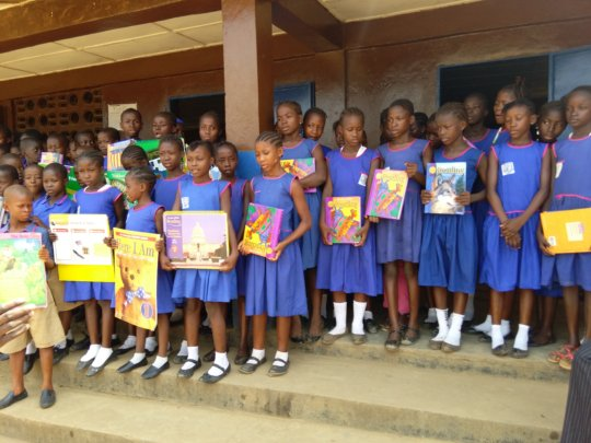 Outside the school - holding the books