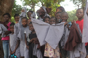 Excited kids with new school uniforms