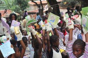 children happy to receive exercise books