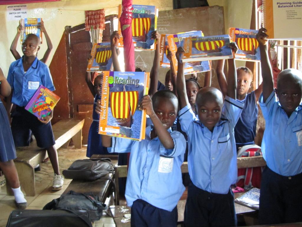 Kids with books at Edmond Mosh Davies school
