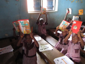 Kids with books at Pilgrims of God Church School
