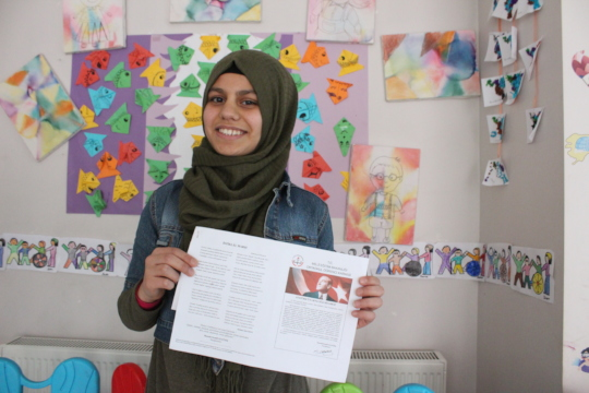 Ragad with her certificate of achievement