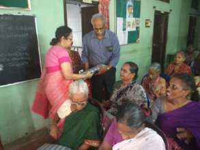 Clothes distribution by Dr. Meher Prasad