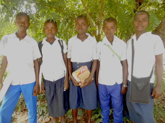 Maombi (center) with 4 of her fellow students
