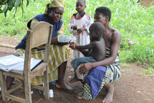 A home visit by a Community Health Worker
