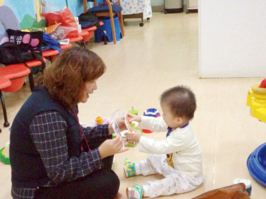 A toddler is undergoing therapy