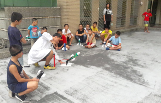 Older children learned to make water rockets.