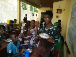 Students at MindLeaps Guinea enjoy a daily meal