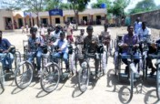 Sponsor tricycles,hearing aids to disable children