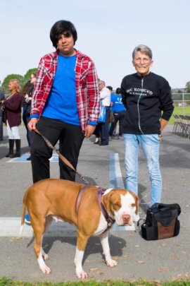TLC student with shelter dog and adopter