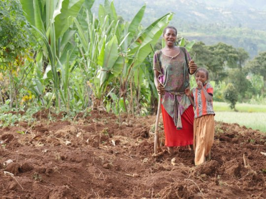 A woman and her daughter grow potatoes to sell