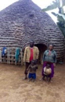 Nigist with her family outside their home