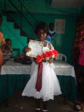 Chelsea Queen holds her certificate