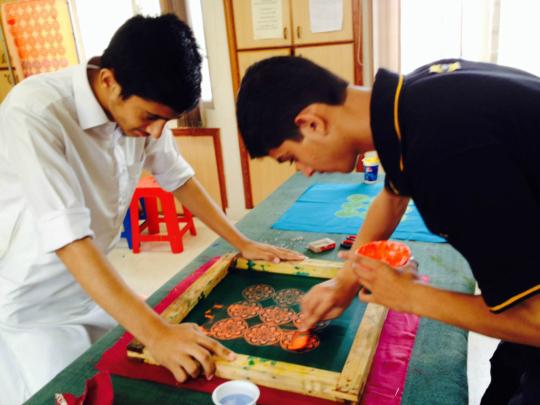 Students hard at work at screen printing training