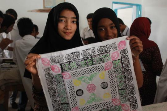 Excited trainees display a block-printed item