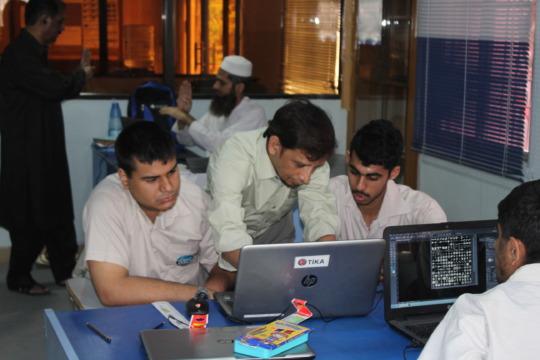 Trainer & trainees on computerized textile design