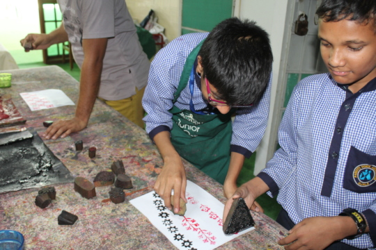 Trainees trying their hand at block print