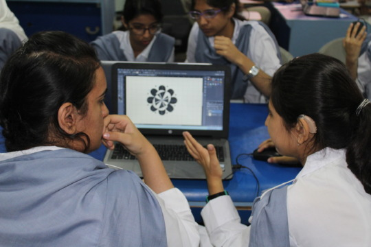 Trainees completing a textile designing assignment