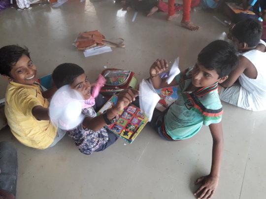 "Kids displaying their ""Paper fan"" models"