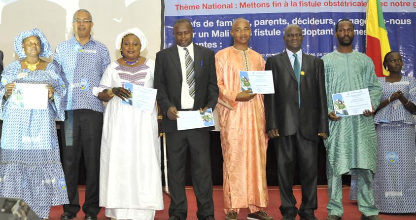 Health workers receiving certificates