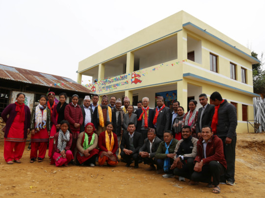The beautiful new school and the school staff.