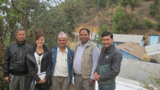 Founder, Marissa, at the school with senior staff