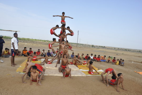 Children practicing Mallakhamb (Gymnastics)