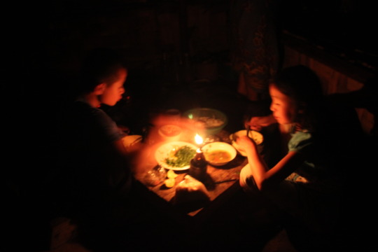 Children using candles as lighting