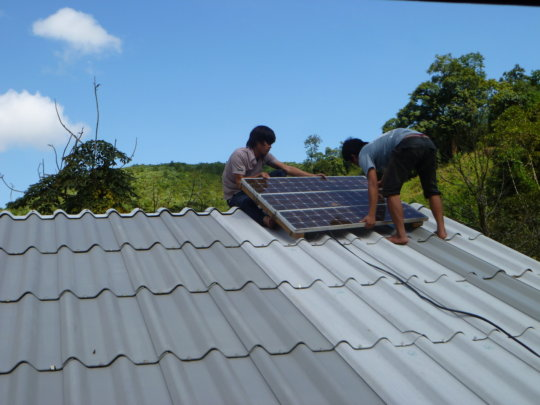 Installing a solar panel on a resident's roof