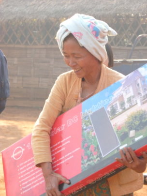 A community resident with her solar panel