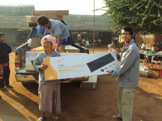 Distributing solar panels in a refugee camp