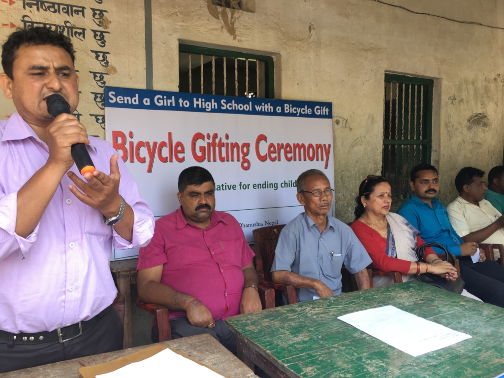 Officials in the bicycle gifting ceremony